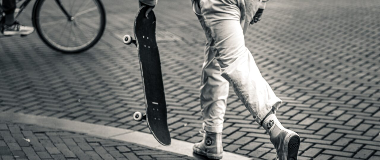 grayscale photography of man playing skateboard