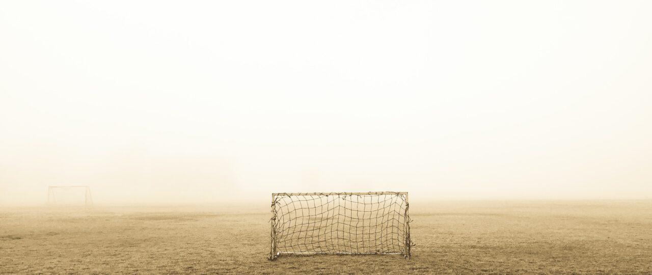 soccer goal on brown field